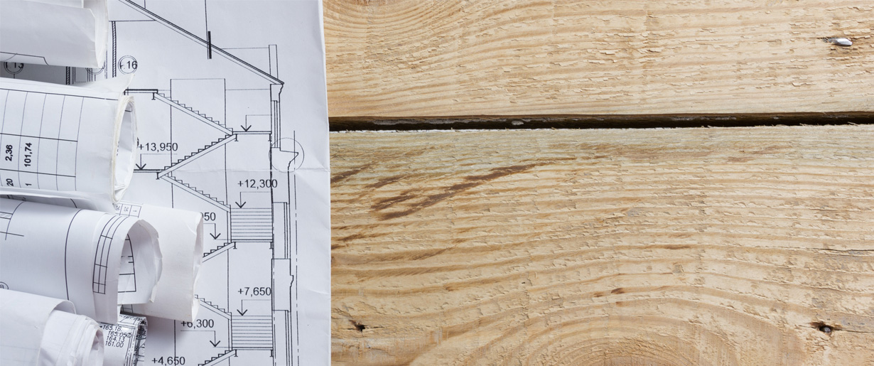 House plans sitting on a wood surface